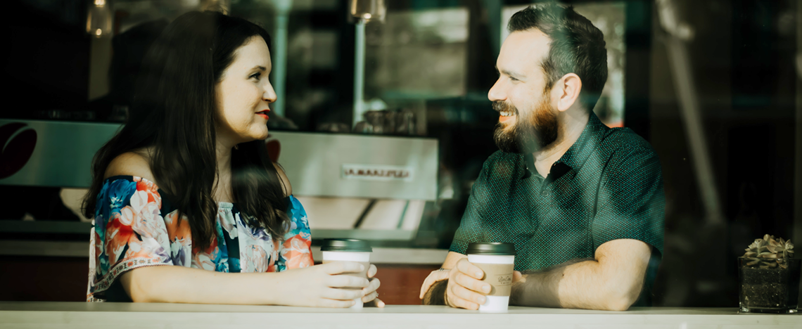 Man and woman chat over a coffee
