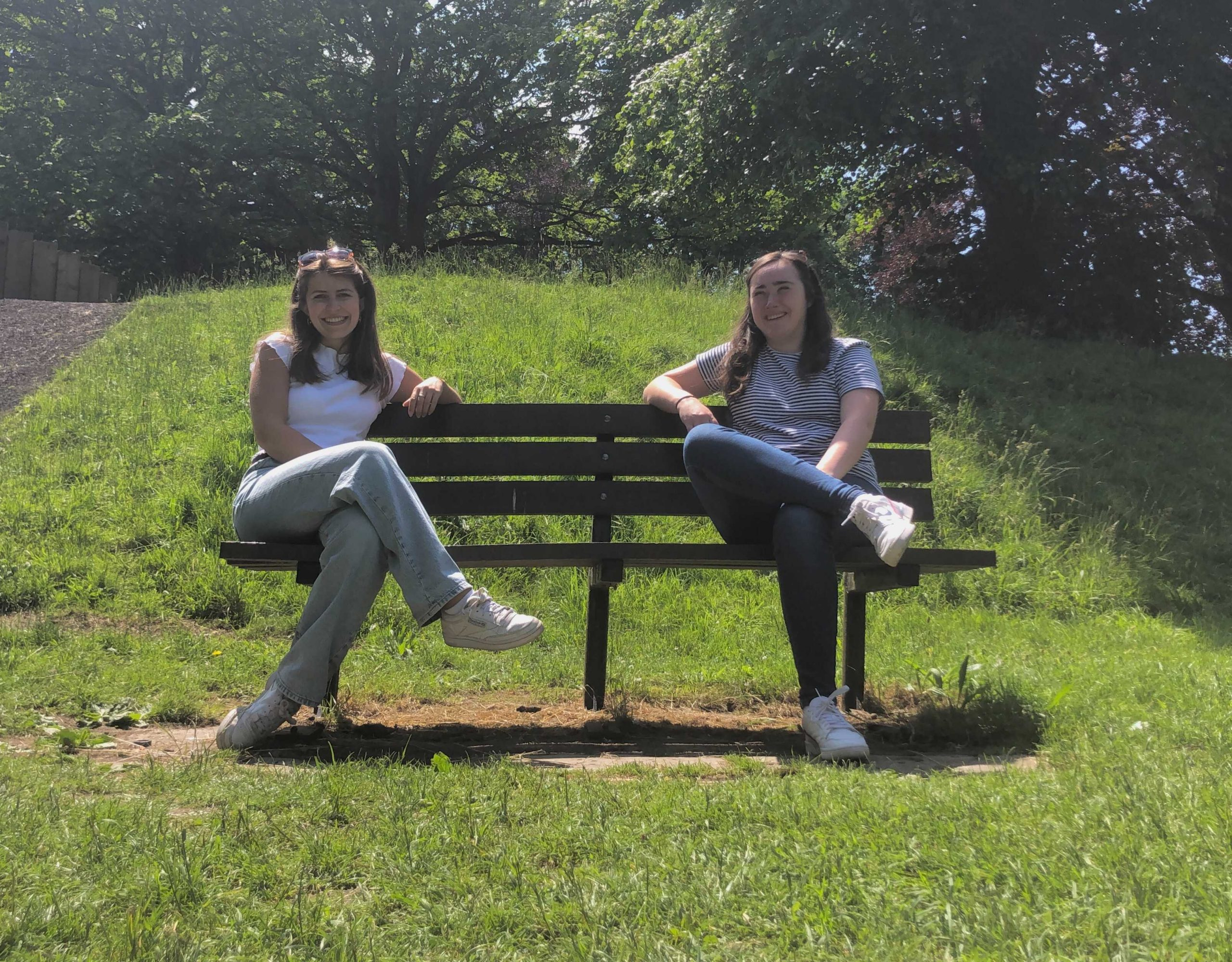 Placement students sat on a bench